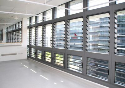 Wall of louvre windows open for natural ventilation