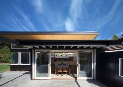 Exterior view of B&W house with Breezway Louvres incorporated into the modern design