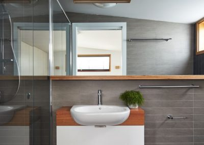 Modern bathroom with timber highlights