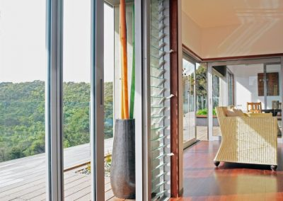 Breezway louvres next to sliding door in living area provides great views