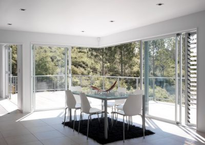Breezway louvres with glass blades next to sliding doors out onto deck