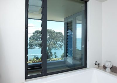 Enjoy uninterrupted views out onto bay with Breezway fixed lite combination