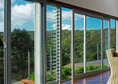 Waiheke home with sliding doors bifold doors and Breezway Louvres