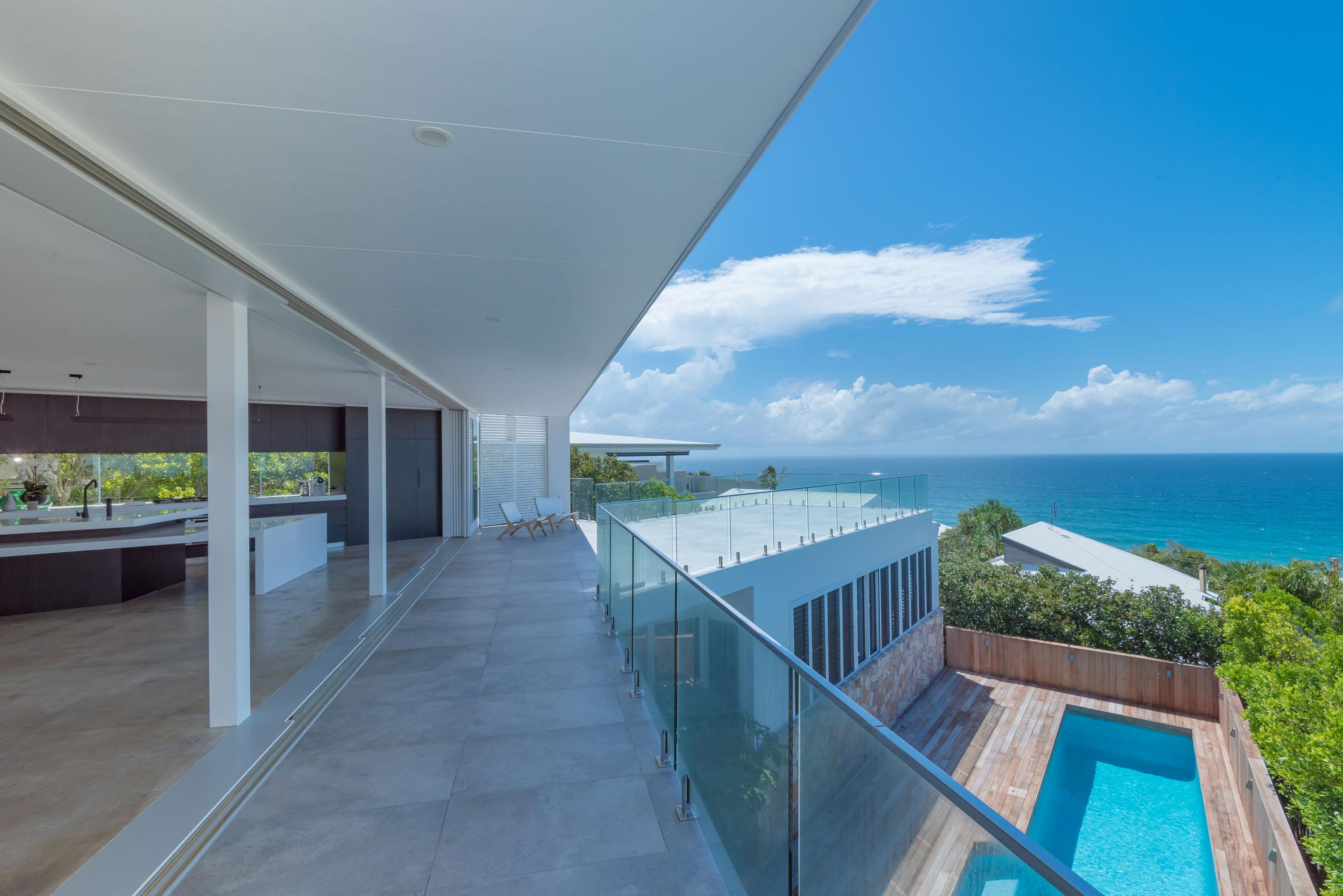 Views out onto sunshine beach with breezway louvres on lower level