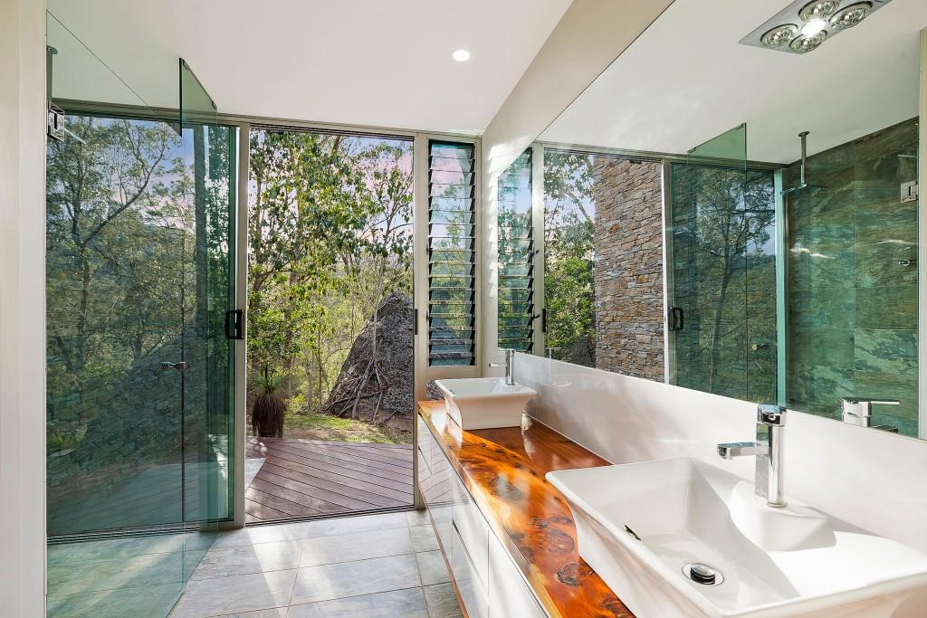 Tall narrow Breezway louvres in the bathroom keep mirrors steam-free