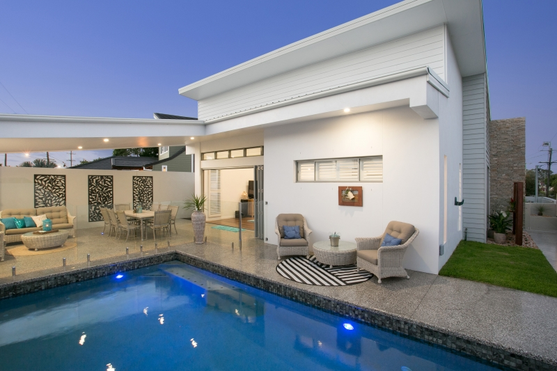 Outdoor pool area with breezway louvres in miami home