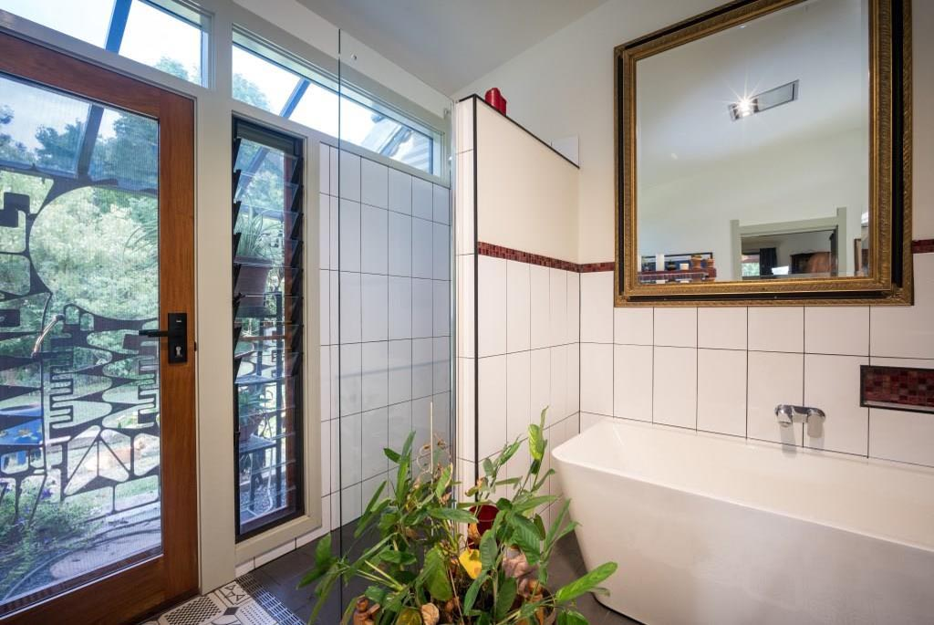 Breezway louvres in the bathroom next to door help ventilate small spaces