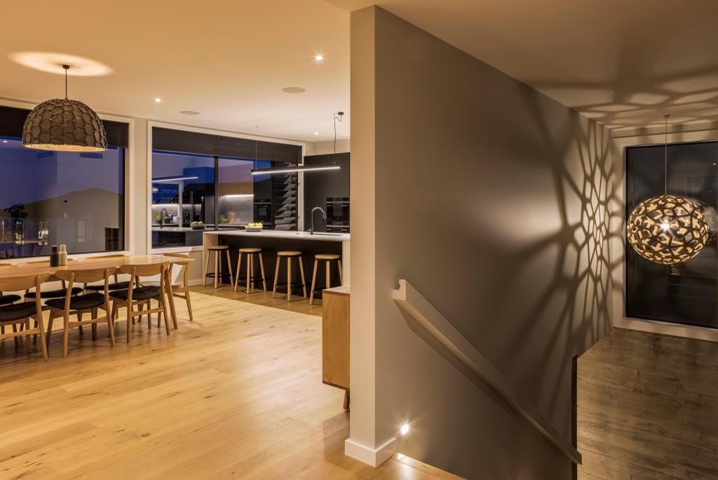 Timber flooring in the Millwater home helps add warmth to the interior design
