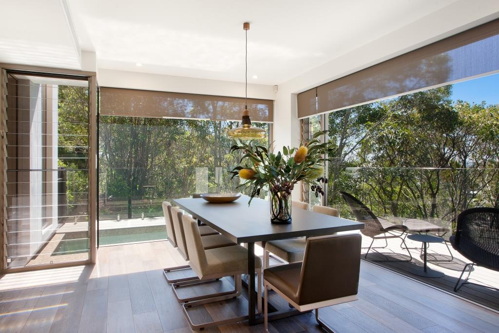 Dining area with strategic placement of Breezway Louvres for cross flow ventilation