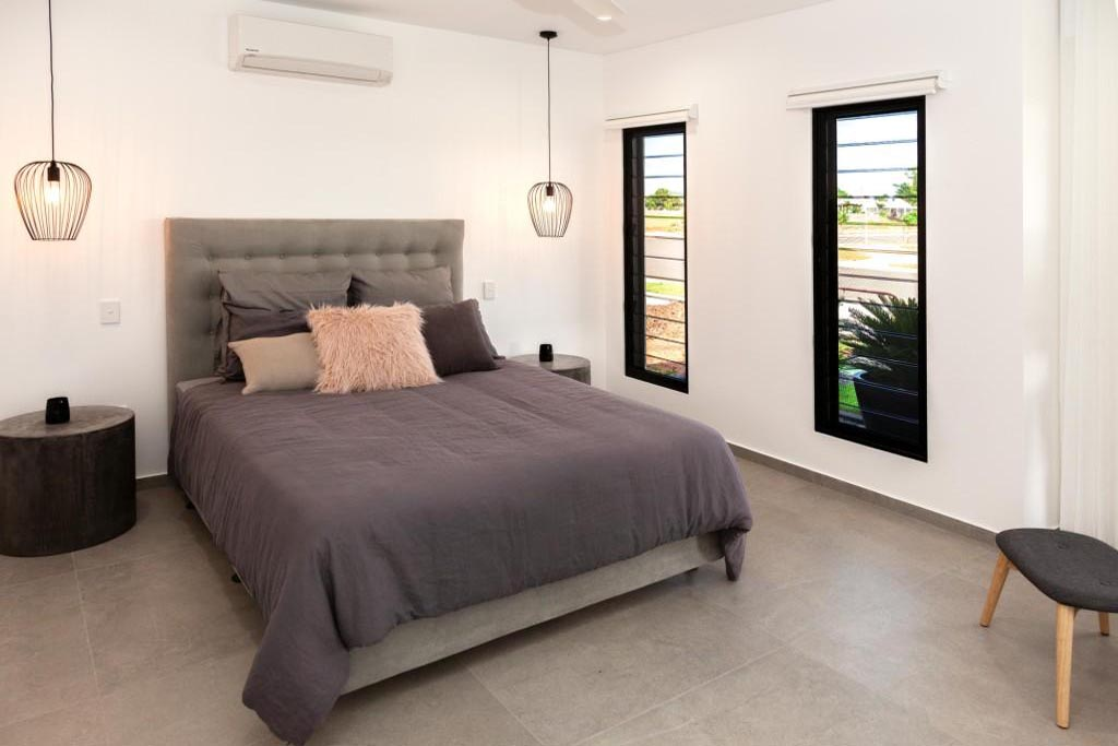 Bedroom of this display home uses two separate Breezway Louvres to allow light and ventilation