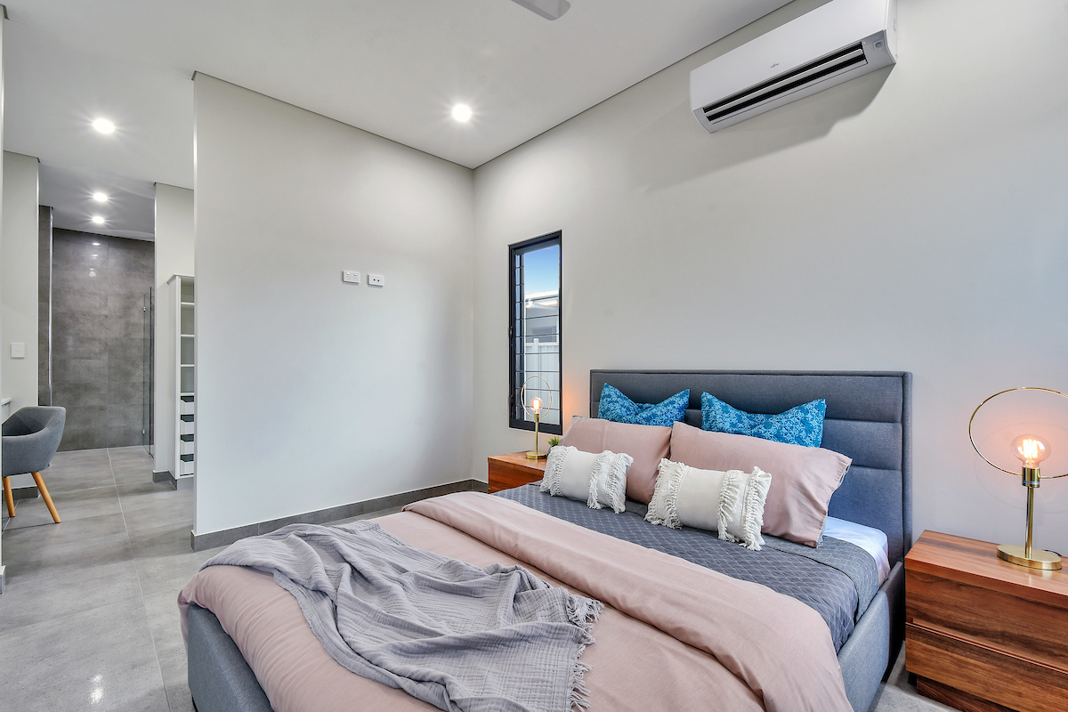 Breezway louvres with clear glass blades are seen in the bedroom for light and ventilation