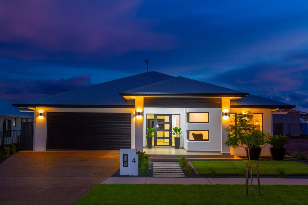 Reuben display home front facade at night