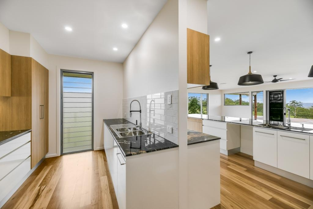 A mix of clear glass and frosted glass blades provide views and privacy in the butlers pantry