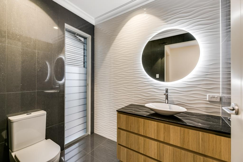 Breezway louvres with a mix of satina and clear glass provides privacy and natural light in bathrooms