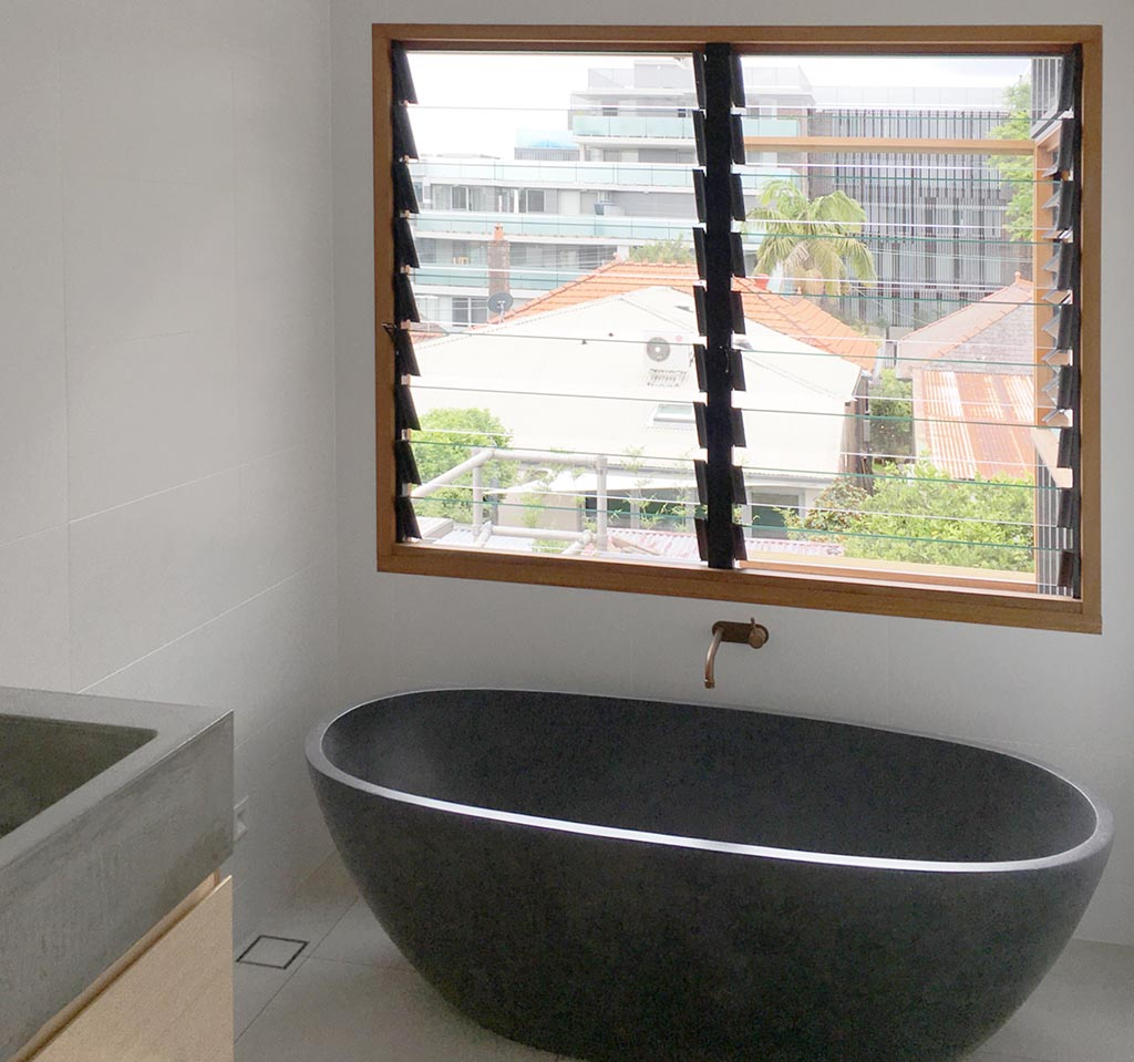 Enjoy the view through Breezway Louvre Windows while relaxing in the bathtub