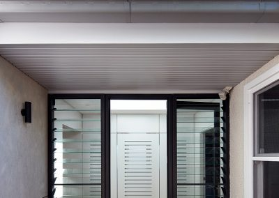 Breezway Louvre Windows can be strategically placed next to doors to allow ventilation even when the door is closed