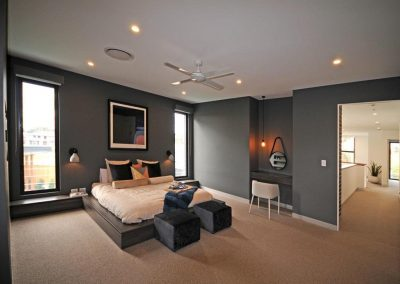 Masterbedroom showcases tall narrow Breezway Louvres either side of the bed for natural light and ventilation